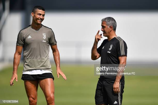 Cristiano Ronaldo of Juventus and Aldo Dolcetti talk during a training session at JTC on August 4 2018 in Turin Italy