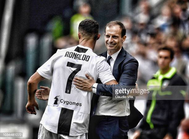 Cristiano Ronaldo of Juventus and head coach Juventus Massimiliano Allegri celebrate after scoring the opening goal during the serie A match between...