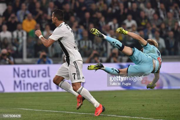 Cristiano Ronaldo of Juventus and Ionut Radu of Genoa compete during the Serie A match between Juventus and Genoa CFC at Allianz Stadium on October...