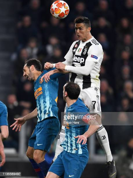 Cristiano Ronaldo of Juventus attempts a header during the UEFA Champions League Round of 16 Second Leg match between Juventus and Club de Atletico...