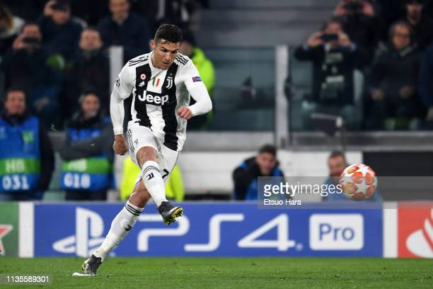 Cristiano Ronaldo of Juventus attempts a shot during the UEFA Champions League Round of 16 Second Leg match between Juventus and Club de Atletico...