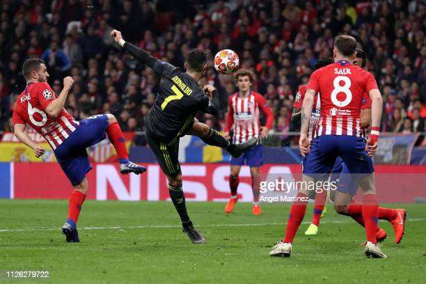 Cristiano Ronaldo of Juventus attempts to control the ball from Koke of Atletico Madrid during the UEFA Champions League Round of 16 First Leg match...