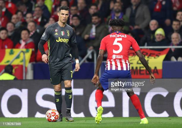 Cristiano Ronaldo of Juventus attempts to get past Thomas Partey of Atletico Madrid during the UEFA Champions League Round of 16 First Leg match...