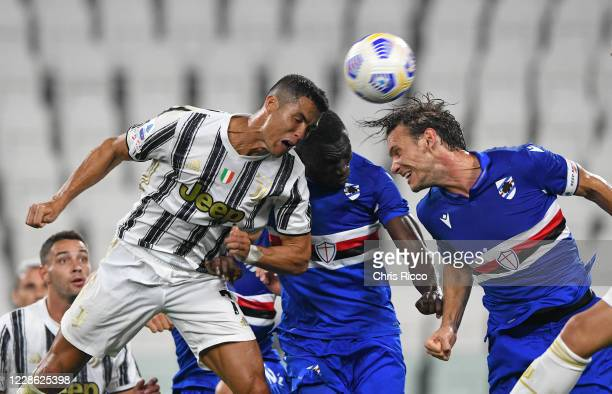 Cristiano Ronaldo of Juventus battles for the ball with Omar Colley of UC Sampdoria and Albin Ekdal of UC Sampdoria during the Serie A match between...