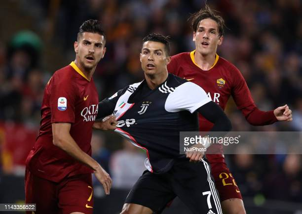 Cristiano Ronaldo of Juventus between Lorenzo Pellegrini and Niccolo Zaniolo of Roma during the Italian Serie A football match AS Roma v Fc Juventus...