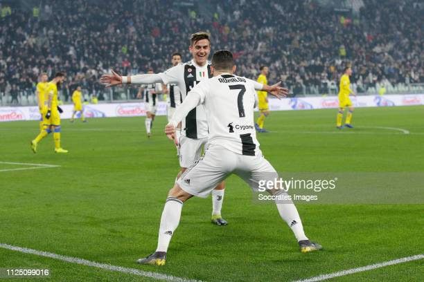 Cristiano Ronaldo of Juventus Celebrates 30 with Paulo Dybala of Juventus during the Italian Serie A match between Juventus v Frosinone at the...