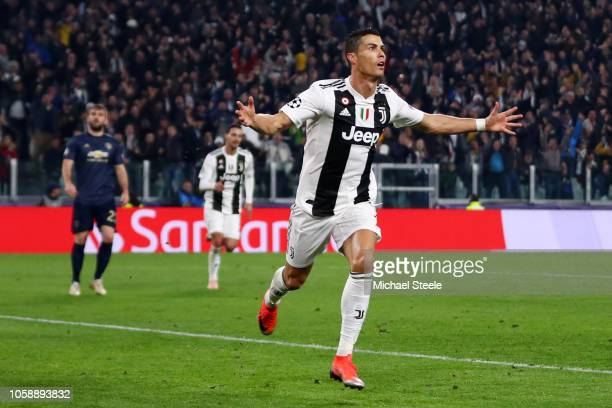 Cristiano Ronaldo of Juventus celebrates after he scores his sides first goal during the UEFA Champions League Group H match between Juventus and...
