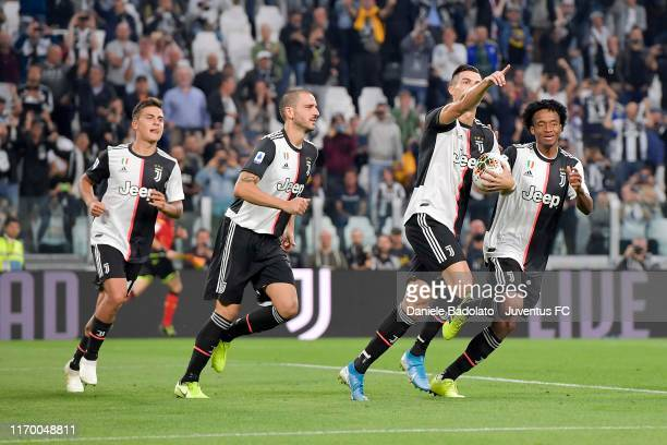 Cristiano Ronaldo of Juventus celebrates after his goal of 2-1 with teammate Paulo Dybala, Leonardo Bonucci and Juan Cuadrado during the Serie A...
