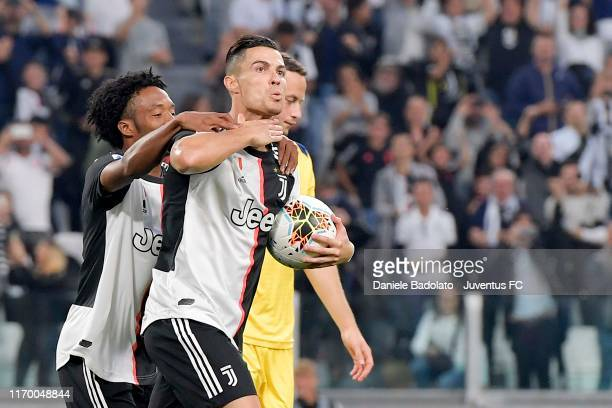 Cristiano Ronaldo of Juventus celebrates after his goal of 2-1 with teammate Juan Cuadrado during the Serie A match between Juventus and Hellas...