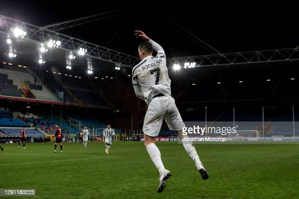 Cristiano Ronaldo of Juventus celebrates after scoring his second penalty to give the side a 3-1 lead during the Serie A match between Genoa CFC and...