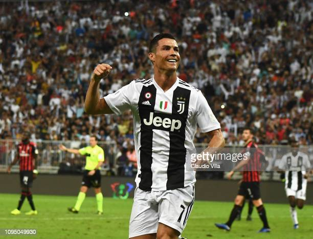 Cristiano Ronaldo of Juventus celebrates after scoring his sides first goal during the Italian Supercup match between Juventus and AC Milan at King...