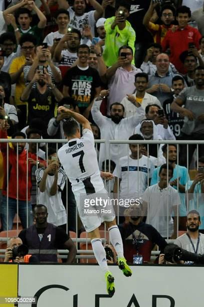 Cristiano Ronaldo of Juventus celebrates after scoring his sides first goal during the Italian Supercup match between Juventus and AC Milan at King...