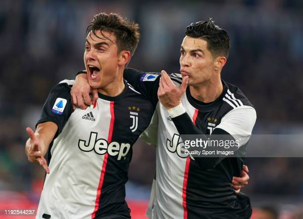 Cristiano Ronaldo of Juventus celebrates after scoring his team's first goal with his teammate Paulo Dybala during the Serie A match between SS Lazio...