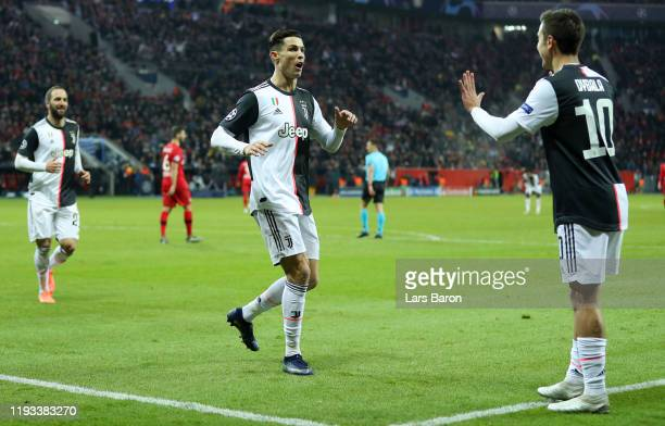 Cristiano Ronaldo of Juventus celebrates after scoring his team's first goal with Paulo Dybala of Juventus during the UEFA Champions League group D...