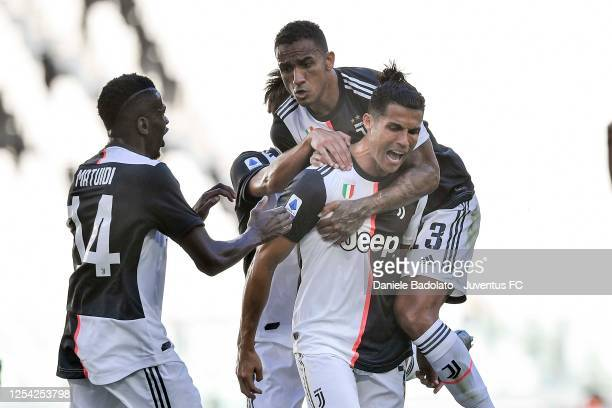 Cristiano Ronaldo of Juventus celebrates after scoring his team's third goal with teammates Danilo and Blaise Matuidi during the Serie A match...