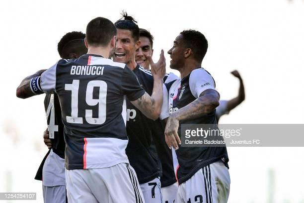 Cristiano Ronaldo of Juventus celebrates after scoring his team's third goal with teammates Leonardo Bonucci, Blaise Matuidi, Danilo and Paulo Dybala...