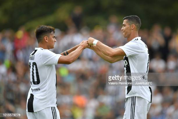 Cristiano Ronaldo of Juventus celebrates after scoring the opening goal with team mate Paulo Dybala during the PreSeason Friendly match between...