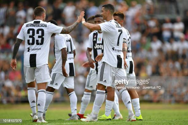Cristiano Ronaldo of Juventus celebrates after scoring the opening goal with team mate Federico Bernardeschi during the PreSeason Friendly match...