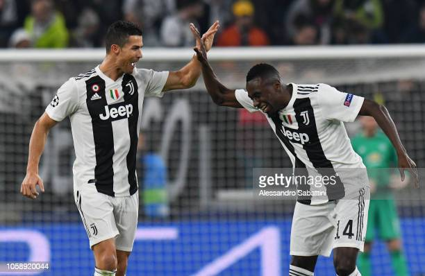 Cristiano Ronaldo of Juventus celebrates after scoring the opening goal with teammate Blaise Matuidi of Juventus during the Group H match of the UEFA...