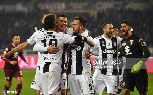 Cristiano Ronaldo of Juventus celebrates after scoring the opening goal from the penalty spot with team mates during the Serie A match between Torino...