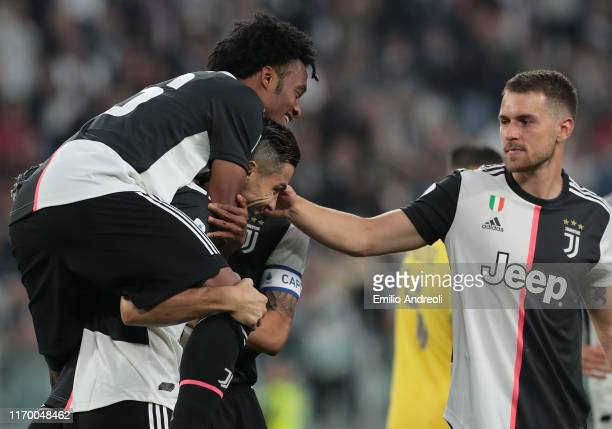 Cristiano Ronaldo of Juventus celebrates after scoring the second goal of his team with teammates Juan Cuadrado and Aaron Ramsey during the Serie A...