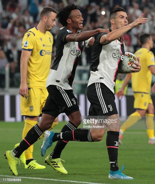 Cristiano Ronaldo of Juventus celebrates after scoring the second goal of his team with teammate Juan Cuadrado during the Serie A match between...