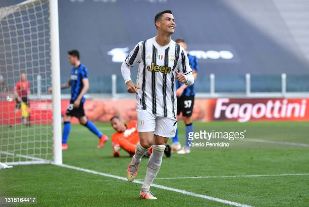 Cristiano Ronaldo of Juventus celebrates after scoring their sides first goal during the Serie A match between Juventus and FC Internazionale at on...