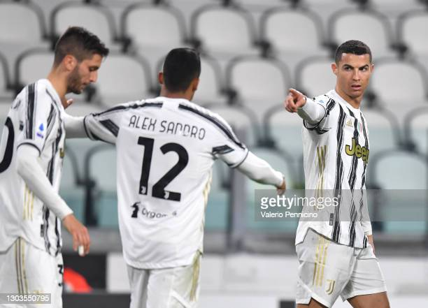 Cristiano Ronaldo of Juventus celebrates after scoring their team's first goal with Alex Sandro of Juventus during the Serie A match between Juventus...