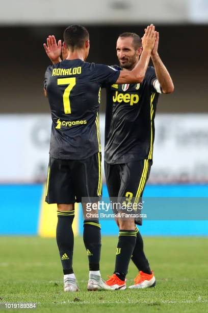 Cristiano Ronaldo of Juventus celebrates at fulltime with teammate Giorgio Chiellini following the Serie A match between Chievo Verona and Juventus...