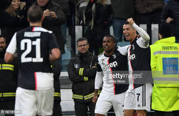 Cristiano Ronaldo of Juventus celebrates goal with teammate Douglas Costa of Juventus during the Serie A match between Juventus and Cagliari Calcio...