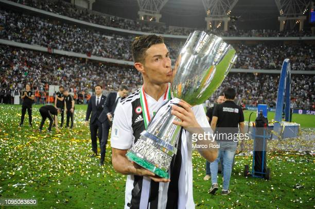 Cristiano Ronaldo of Juventus celebrates kissing the trophy after winning the Italian Supercup match between Juventus and AC Milan at King Abdullah...