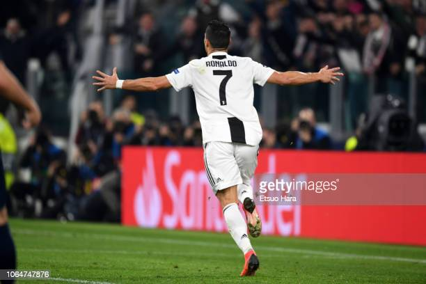 Cristiano Ronaldo of Juventus celebrates scoring his side's first goal during the Group H match of the UEFA Champions League between Juventus and...
