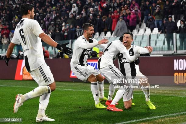 Cristiano Ronaldo of Juventus celebrates the opening goal of 10 with teammates Blaise Matuidi Leonardo Spinazzola and Sami Khedira during the Serie A...