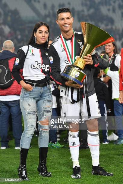 Cristiano Ronaldo of Juventus celebrates with Georgina Rodriguez during the awards ceremony after winning the Serie A Championship during the Serie A...