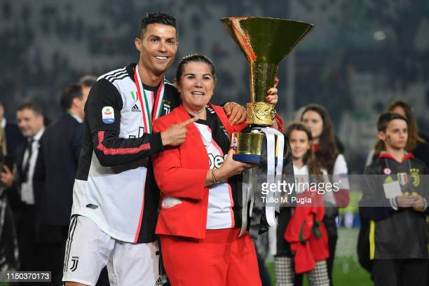 Cristiano Ronaldo of Juventus celebrates with his mother Maria Dolores Aveiro during the awards ceremony after winning the Serie A Championship...