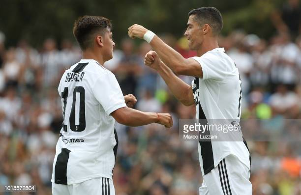 Cristiano Ronaldo of Juventus celebrates with his teammate Paulo Dybala after scoring the opening goal during the PreSeason Friendly match between...