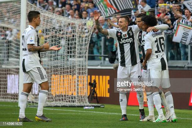 Cristiano Ronaldo of Juventus celebrates with his teammates after German Pezzella of ACF Fiorentina scored an own goal during the Serie A match...