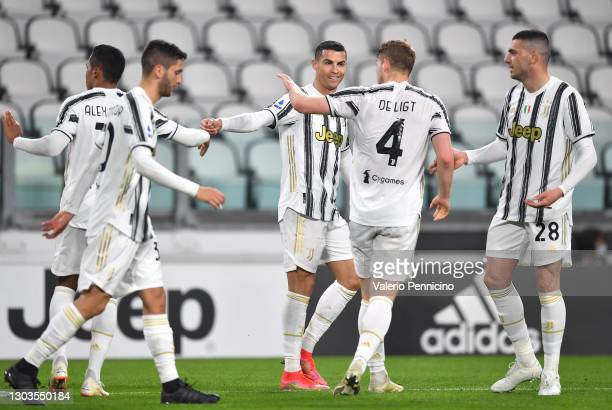 Cristiano Ronaldo of Juventus celebrates with Matthijs de Ligt of Juventus and Merih Demiral of Juventus after he scores their team's first goal...