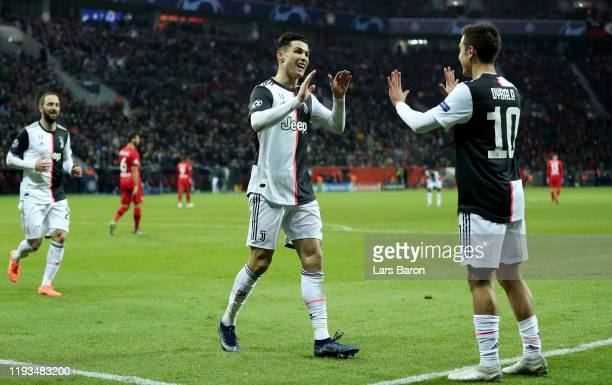 Cristiano Ronaldo of Juventus celebrates with Paulo Dybala of Juventus after scoring his teams first goal during the UEFA Champions League group D...