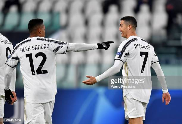 Cristiano Ronaldo of Juventus celebrates with team mate Alex Sandro after scoring their sides second goal during the UEFA Champions League Group G...