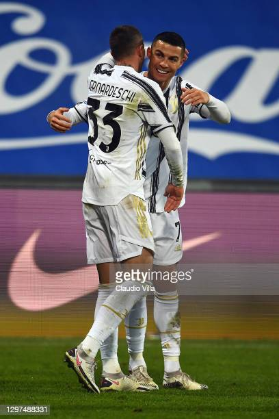 Cristiano Ronaldo of Juventus celebrates with team mate Federico Bernardeschi after scoring their sides first goal during the Italian PS5 Supercup...