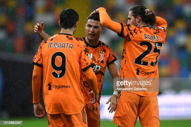 Cristiano Ronaldo of Juventus celebrates with team mates Alvaro Morata and Adrien Rabiot after scoring their side's second goal during the Serie A...