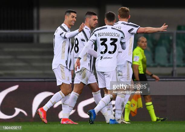 Cristiano Ronaldo of Juventus celebrates with team mates Federico Bernardeschi, Matthijs De Ligt and Merih Demiral after scoring their side's first...