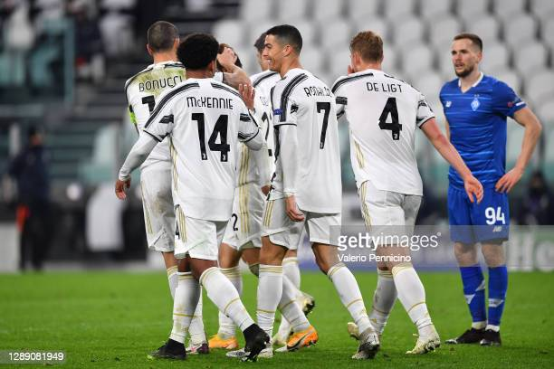 Cristiano Ronaldo of Juventus celebrates with team mates Matthijs De Ligt, Weston McKennie and Leonardo Bonucci of Juventus after scoring their sides...