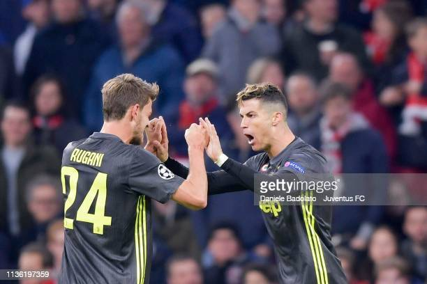 Cristiano Ronaldo of Juventus celebrates with teammate Daniele Rugani after scoring the opening goal during the UEFA Champions League Quarter Final...