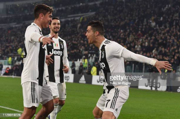 Cristiano Ronaldo of Juventus celebrates with teammate Paulo Dybala after scoring his team's third goal during the Serie A match between Juventus and...