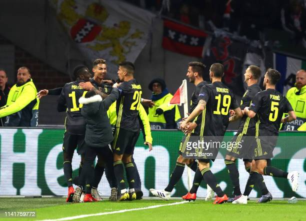 Cristiano Ronaldo of Juventus celebrates with teammates after scoring his team's first goal during the UEFA Champions League Quarter Final first leg...