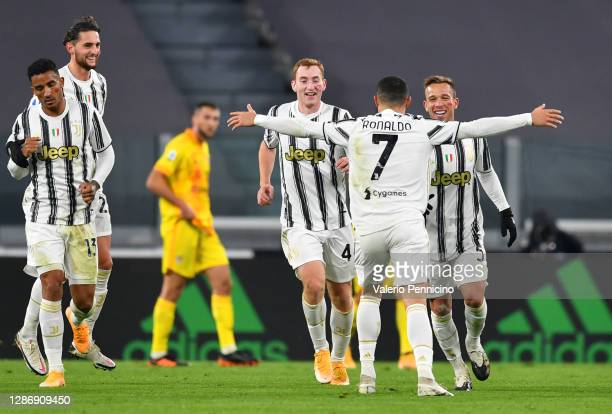 Cristiano Ronaldo of Juventus celebrates with teammates Dejan Kulusevski and Melo Arthur after scoring his team's first goal during the Serie A match...