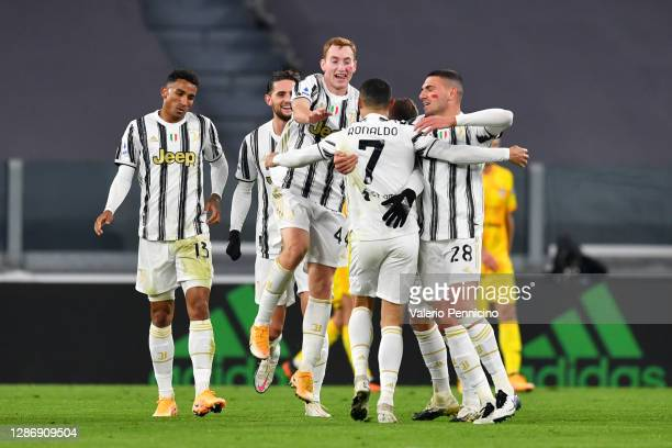 Cristiano Ronaldo of Juventus celebrates with teammates Dejan Kulusevski and Merih Demiral after scoring his team's first goal during the Serie A...