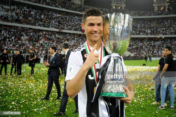 Cristiano Ronaldo of Juventus celebrates with the trophy after winning the Italian Supercup match between Juventus and AC Milan at King Abdullah...